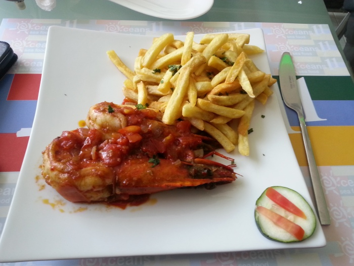 Grilled Jumbo Prawns in Alfredo Sauce with French Fries.