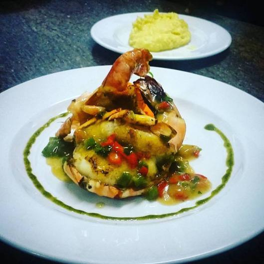 Tiger prawns in garlic butter sauce with mashed potatoes